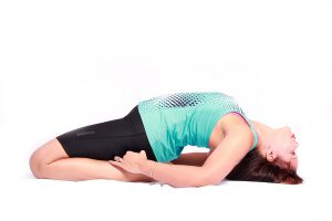 Women doing yoga pose